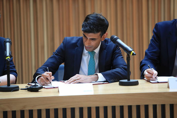 Britain's Chancellor of the Exchequer Rishi Sunak signs the West Yorkshire Combined Authority devolution deal during a visit to the Nexus Building at the University of Leeds, in Leeds