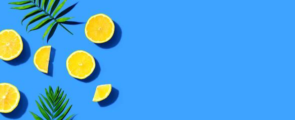 Wall Mural - Fresh yellow lemons overhead view - flat lay