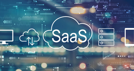 SaaS - software as a service concept with blurred city abstract lights background