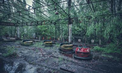 Foto op Textielframe Amusementspark Broken metal radioactive cars in amusement park in Pripyat, the Chernobyl disaster, Ukraine