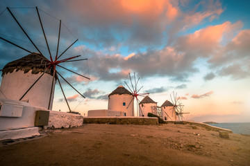 Picturesque view of Mykonos windmills at sunset Fotomurales