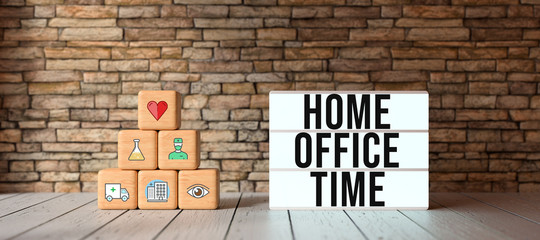 Photo sur Aluminium Pays d Afrique cubes with health-symbols stacked as a pyramid and lightbox with text HOME OFFICE TIME in front of a brick wall
