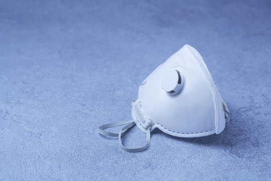 White ffp3 face mask with a valve