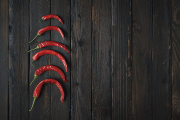 Canvas Prints Hot chili peppers Red chillies on a dark wooden background.