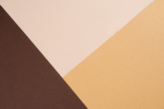 Background from recycled textured paper forming triangular shades of dark brown