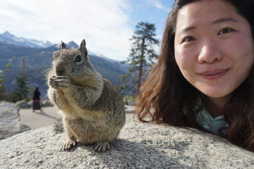 Portrait Of Woman Posing With Squirrel
