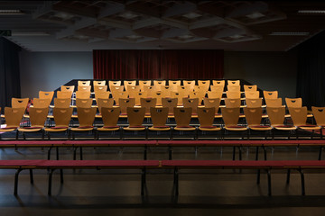 empty chairs in the auditorium of a small theatre, copy space