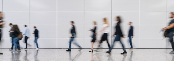 Wall Mural - Anonymous blurred business people walk around in the office or at the trade fair
