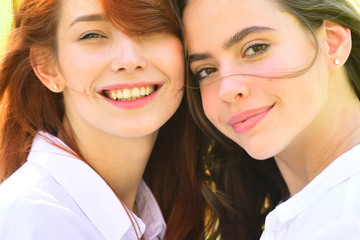 Close up portrait. Two young girl friends having fun and smiling.