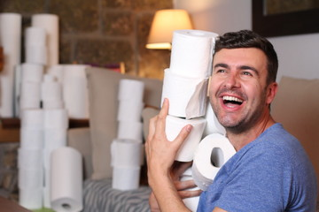 Canvas Prints Akt Man stocking up toilet paper at home