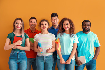 Young students of language school on color background