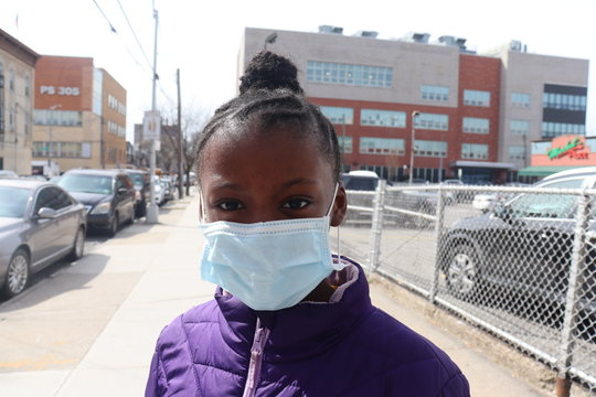 Girl on street wearing surgical face mask