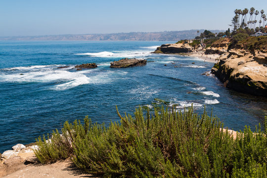 A view of people at La Jolla Cove from atop a cliff in La Jolla, California in San Diego County.