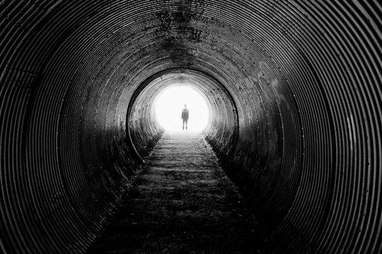 Silhouette Person In Tunnel