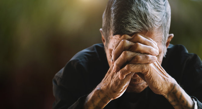 senior man covering his face with his hands. Depression and anxiety Copy space.