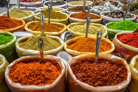 Colorful spices of many varieties stacked up for sale in traditional open air market of India. These spices are used as condiments, to flavor the food and is widely popular among foreign tourists.