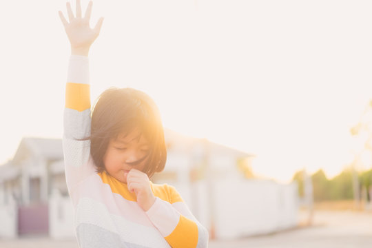 Kid girl praying and worship to GOD.Little girl praying to The LORD in the morning.Hand praying,Raised Hands in prayer on the sky in the morning concept for faith, spirituality,Freedom and religion.