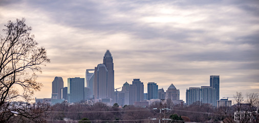 Wall Mural - sunset and overcast over charlotte nc cityscape