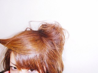 Cropped Image Of Woman With Brown Hair Against White Wall Wall mural