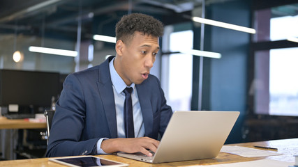 Young Businessman feeling Shocked in Office