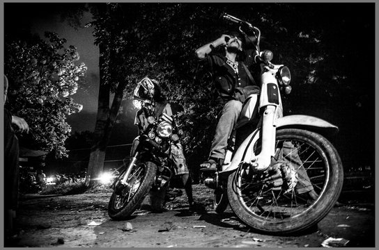 Men Sitting On Motorcycles Against Trees