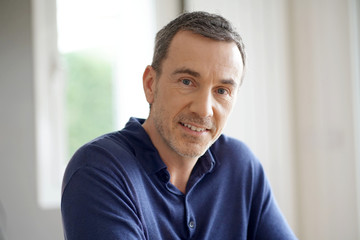 Obraz Portrait of middle-aged man with blue shirt - fototapety do salonu