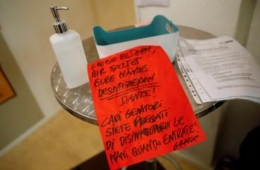 Hand disinfection kit is pictured at German-Italian language Kindergarten Asilo Italiano in Berlin