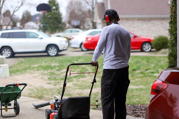 A African-American man with a lawnmower