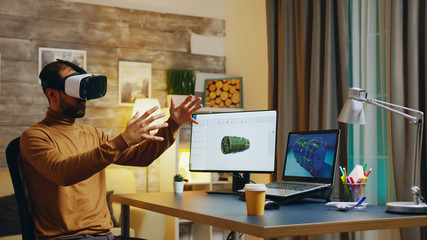 Engineer with virtual reality headset at his desk