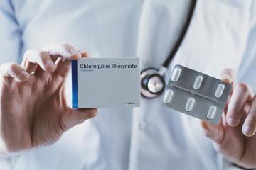 Doctor holding Chloroquine Phosphate drug