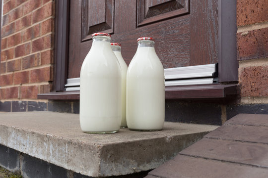 Fresh milk in recyclable glass bottles delivered to the door by a traditional milk man