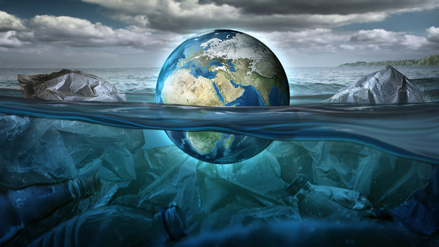 The Earth floats in the sea full of garbage and pollution. Environment concept. Earth image provided by NASA