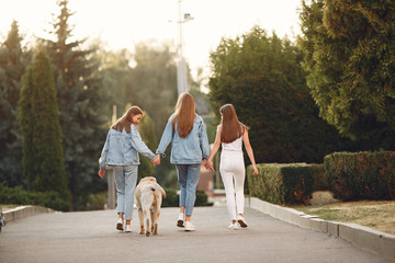 Beautiful girls walking. Women in a spring city. Ladies with cute dog.
