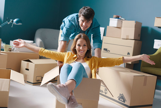 Cheerful young couple moving in their new house