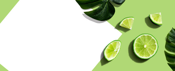 Wall Mural - Fresh green limes overhead view - flat lay