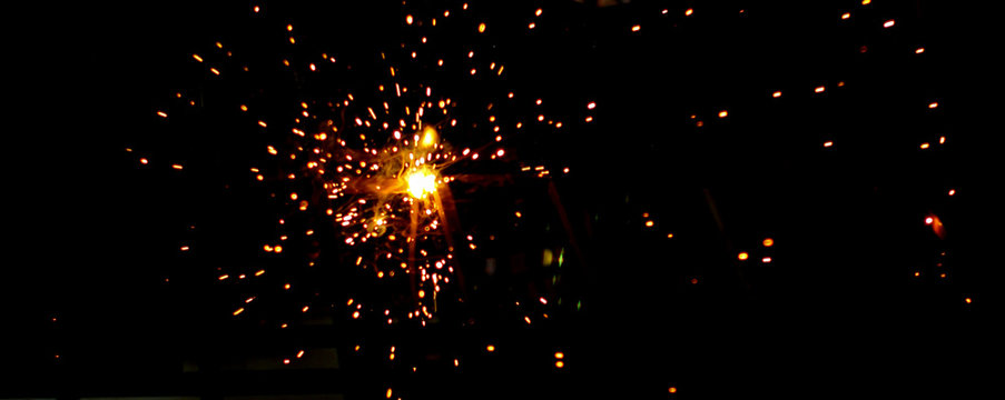 Fire sparks of metal welding isolated on transparent background. During iron cutting.