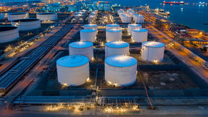 Aerial view oil and gas terminal storage tank farm,Tank farm storage chemical petroleum petrochemical refinery product, Business commercial trade fuel and energy transport by tanker vessel. Fototapete