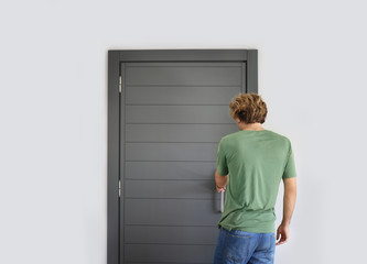 Man opening the door of her home.Inviting the guests