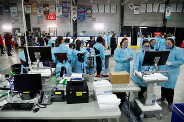 Medical staff prepare to receive patients for coronavirus screening at a temporary assessment center at the Brewer hockey arena in Ottawa
