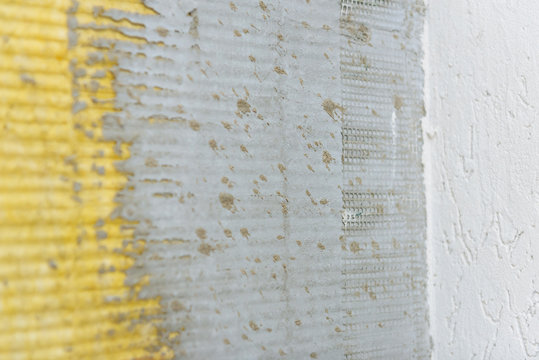 a fragment of the outer wall during the repair of the building with the application of plaster and installation of insulation