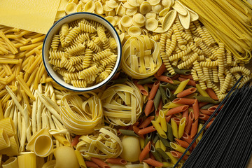 different types of pasta lie on the table