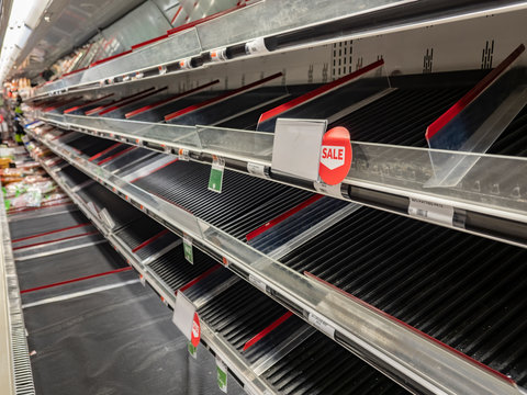 Empty shelves at local supermerketEmpty meat isle at supermarket after virus outbreak causes panic and people panic buy produce,.