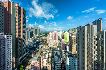 Cityscape of Hong Kong buildings with cloudy blue sky in morning, high angle view taken from a hotel in Yau Ma Tei (Kowloon, Hong Kong) Fotomurales