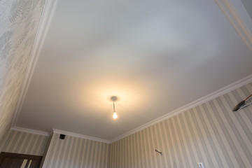 Plastered lined ceilings in the kitchen after renovation