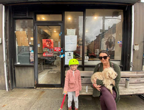 Jane Trachet poses for a photo with her daughter and dog in Brooklyn