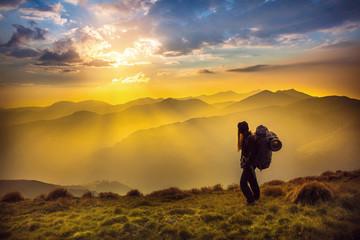 Canvas Prints Honey Hiker silhouette enjoying sunset landscape