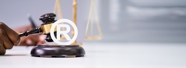 Judge Striking Mallet On Trademark Symbol