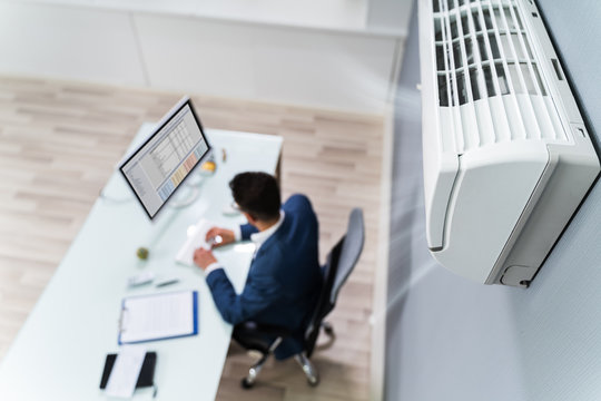 Businessman Enjoying The Cooling Of Air Conditioner
