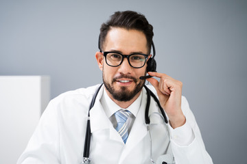Confident Receptionist Using Headset In Hospital