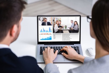 Businesspeople Video Conferencing With Colleagues